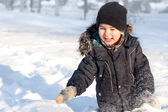 Happy boy playing in snow — Stock Photo