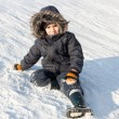Stock Photo: Young boy on snow
