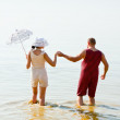Man and a woman in vintage striped bathing suits — Stock Photo