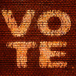 Word Vote on a brick wall — Stock fotografie
