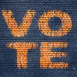 Word Vote on a brick wall — Photo