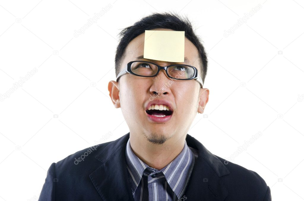 Young businessman helpless looking the post it — Stock Photo #10119020