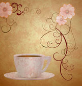 Pink flowers and coffee cup on brown grunge paper background — Stock Photo