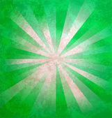 Grunge paper background with green light beams — Stock Photo