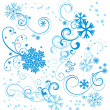 Royalty-Free Stock Photo: Vector set of blue snowflakes with flourishes and stars isolated