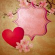 Royalty-Free Stock Photo: Pink heart hanging on the blooming tree brunch on grunge dark bl