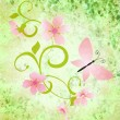 Spring green grunge background with pink flowers and butterflies — Stock Photo