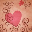 Stock Photo: Pink heart on brown grunge paper background with flourishes and