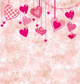 Different pink hanging hearts on the grunge light paper backgrou — Stock Photo