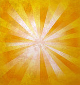 Yellow rays of light from center to the edges grunge background — Stock Photo