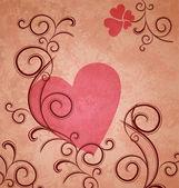Rosa corazón sobre papel marrón grunge con florituras y — Foto de Stock