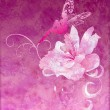 Pink little flower fairy on the dark magenta spring or summer gr — Stock Photo
