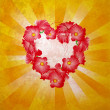 Flowers heart on yellow light rays grunge background - Stock Photo