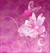 Pink little flower fairy on the dark magenta spring or summer gr — Stock Photo