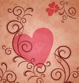 Pink heart on brown grunge paper background with flourishes and — Stock Photo