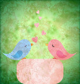 Blue and pink birds in love on grunge retro paper background — Stock Photo