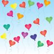 Stock Photo: Colorful heart-shaped balloons in the blue sky