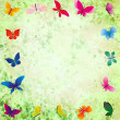 Stock Photo: green grunge background with colorful butterflies frame
