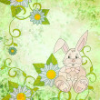 Cartoon rabbit with daisies on green grunge background — Stock Photo