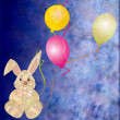 Brown grey toy rabbit with three color balloons — Stockfoto