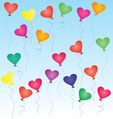 Colorful heart-shaped balloons in the blue sky — Stock Photo