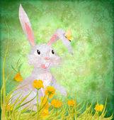 Easter rabbit with yellowflowers on grunge paper green backgroun — Stock Photo