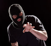 Aggressive burglar in black mask — Stock Photo