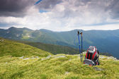 Hiking pole and backpack in mountain — Stock Photo
