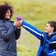 Son giving flowers to his mother - Stockfoto
