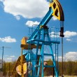 Oil pump under blue sky - Lizenzfreies Foto