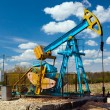 Oil pump under blue sky - Stok fotoğraf