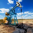 Stock Photo: Oil pump under blue sky