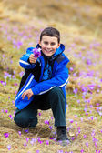 Boy offering a bunch of flowers — Stock Photo