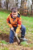 Boy digging in the ground — Stock Photo