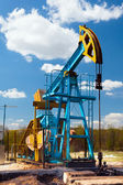 Oil pump under blue sky — Stock Photo