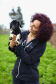 Woman holding a baby goat — Stock Photo