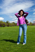Young woman in a park — Stock Photo