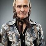 Elderly woman with kerchief — Stock Photo