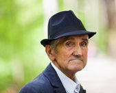 Old man with hat outdoor — Stock Photo