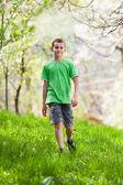 Boy walking outdoor — Stock Photo