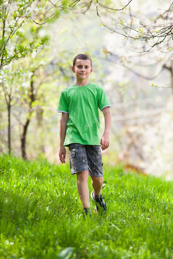 Full length portrait of a boy walking outdoor in a forest — Stock Photo #10475855
