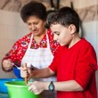 Grandson and grandmother making cookies — Stock Photo
