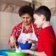 Grandson and grandmother making cookies — Photo