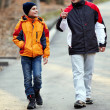 Father and son walking in the park — Stock Photo #8475494