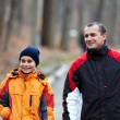 Father and son walking in the park — Stock Photo #8475509
