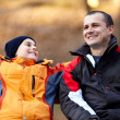 Father and son on a bench in park — Stock Photo #8475514