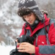 Tourist with camera outdoor — Stock Photo