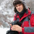 Tourist with camera outdoor - Stockfoto