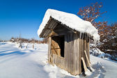 Wooden shack in the winter — Stock Photo
