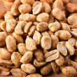 Pile of peanuts on a wooden board — Stock Photo